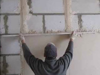 Достоинства и недостатки штукатурки фасада дома из газобетона