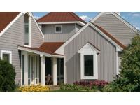 Плюсы, минусы и монтаж вертикальных фасадных панелей