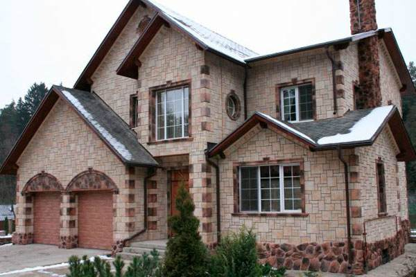 Фасады домов из искусственного камня фото